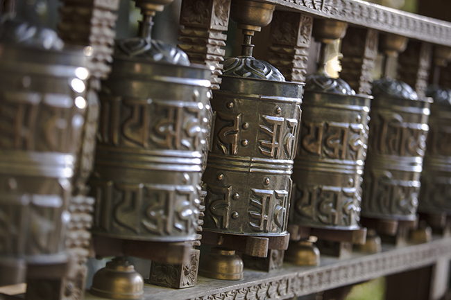 Tibetan prayer wheels in Buddhism temple